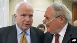 Sen. Carl Levin (R) and Senator John McCain talk about the Chinese government's failure to cooperate in an ongoing Senate Armed Services Committee investigation into counterfeit parts in the Defense Department supply chain, on Capitol Hill in Washington,