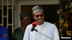 FILE - Nigeria's President Muhammadu Buhari. Ibrahim Mustafa Magu will replaces Ibrahim Lamorde as the country's anti-corruption chief.