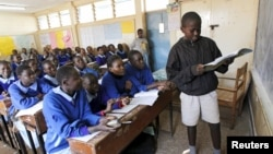 Pupils revise their class work without a teacher on the second week of a national teachers' strike, at Olympic Primary School in Kenya's capital Nairobi, September 9, 2015.