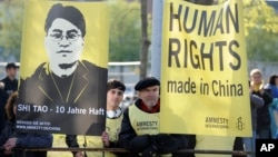 Amnesty International activists rally in support of Chinese dissident Shi Tao in Hannover, Germany, in this April 22, 2012, file photo.