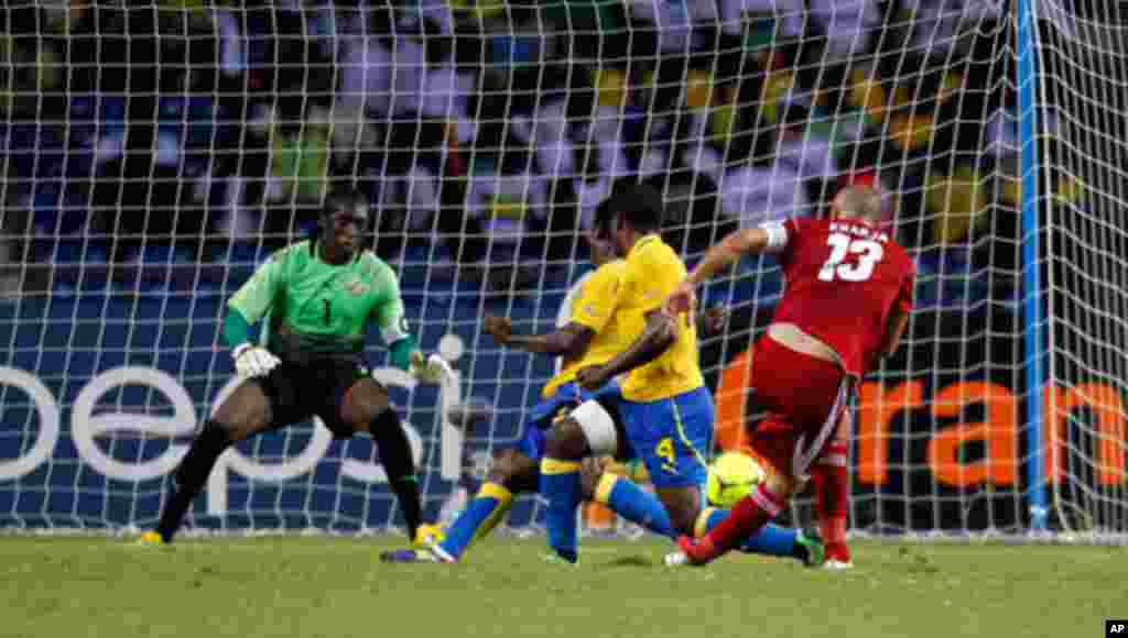 Morocco's Kharja scores his goal against Gabon during their African Cup of Nations soccer match in Libreville