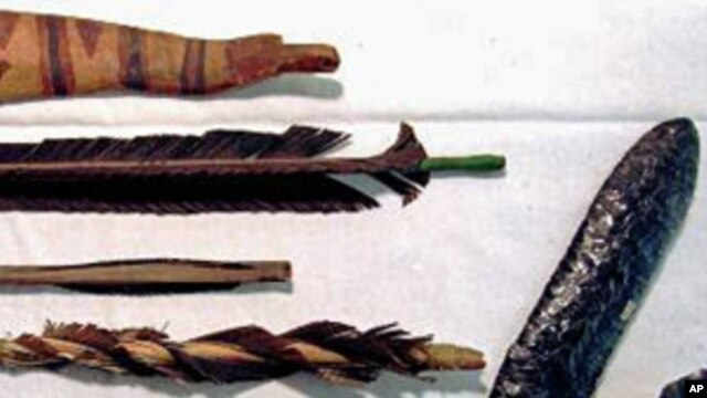Arrows, a bow (top) and stone cutting tools that are part of a Klamath tribes artifacts collection (not related to the Texas discovery)
