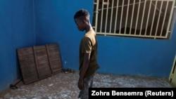 Fallou Diop, a 19-year-old horse jockey, prays at the Lambafar stable in Niaga, Rufisque region, Senegal, January 27, 2021. (REUTERS/Zohra Bensemra)