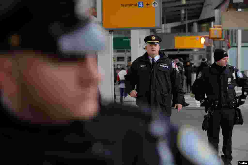 Police guard an entrance during anti-Donald Trump immigration ban protests outside Terminal 4 at John F. Kennedy International Airport in Queens, New York, Jan. 28, 2017.