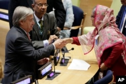Bangladesh Prime Minister Sheikh Hasina Wazed, right, is greeted by United Nations Secretary General Antonio Guterres, left, in the High-Level meeting on the Prevention of Sexual Exploitation and Abuse, at United Nations headquarters, Sept. 18, 2017.