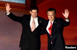 FILE - Republican presidential nominee Mitt Romney, right, and vice presidential running mate Paul Ryan wave after Romney's acceptance speech at the final session of the Republican National Convention in Tampa, Fla., Aug. 30, 2012.