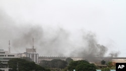 Smoke rises from the city center of Abidjan, April 2, 2011