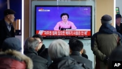 People watch a TV news program showing North Korea's announcement, at the Seoul Railway Station in Seoul, South Korea, Wednesday, Jan. 6, 2016.