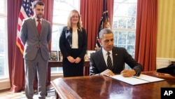 """President Barack Obama signs an Executive Order, entitled """"Planning for Sustainability in the Next Decade,"""" which will cut the Federal Government's greenhouse gas (GHG) emissions over the next decade, March 19, 2015."""