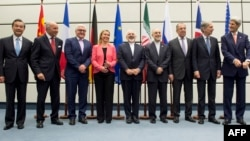 Leaders involved in Iran nuclear talks pose for group photo, July 14, 2015.