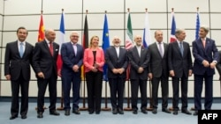 FILE - Leaders who were involved in Iran nuclear talks are seen posing for a group photo in Vienna, Austria, July 14, 2015.
