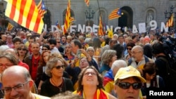 FILE - Catalan independence supporters are seen gathered in front of the Palau de la Generalitat (Government Palace) in Barcelona Sept. 27, 2014.