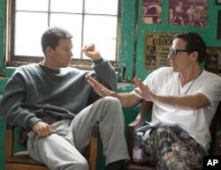 Left to right: Mark Wahlberg (as Micky Ward) with Director David O. Russell on the set of THE FIGHTER.