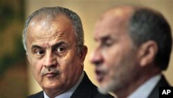 U.N. envoy Abdelilah Al-Khatib (L) and Mustafa Abdul-Jalil (R) head of the opposition's interim governing council based in Benghazi, at a joint press conference in Benghazi,Apr 1 2011