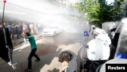 Police use water cannons against protesters as they demonstrate to blame the ruling AK Party (AKP) government for the mining disaster in Soma, a district in Turkey's western province of Manisa, May 16, 2014.