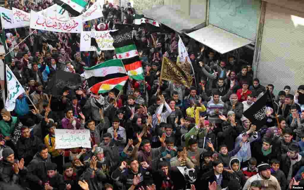 Demonstrators during a protest against Syria's President Bashar al-Assad in Aleppo's al-Sha'ar district, January 25, 2013.