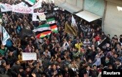 FILE - Demonstrators protest Syria's President Bashar al-Assad in Aleppo's al-Sha'ar district, Jan. 25, 2013.