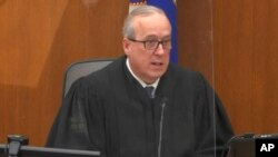 In this screen grab from video, Hennepin County Judge Peter Cahill presides over jury selection in the trial of former Minneapolis police officer Derek Chauvin on Tuesday, March 9, 2021 at the Hennepin County Courthouse in Minneapolis.