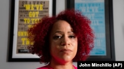 Nikole Hannah-Jones at her home in the Brooklyn borough of New York, Tuesday, July 6, 2021. Hannah-Jones says she will not teach at the University of North Carolina at Chapel Hill following a long fight over tenure. She has accepted a position at Howard University in Washington, D.C. (AP Photo/John Minchillo)