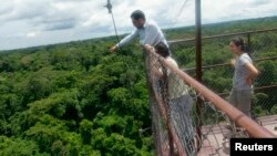 Research assistant Fabian Limonchi checks equipment on a 42-meter observation tower in the Tambopata National Reserve in the Amazon rainforest in Madre de Dios, Dec. 4, 2012.
