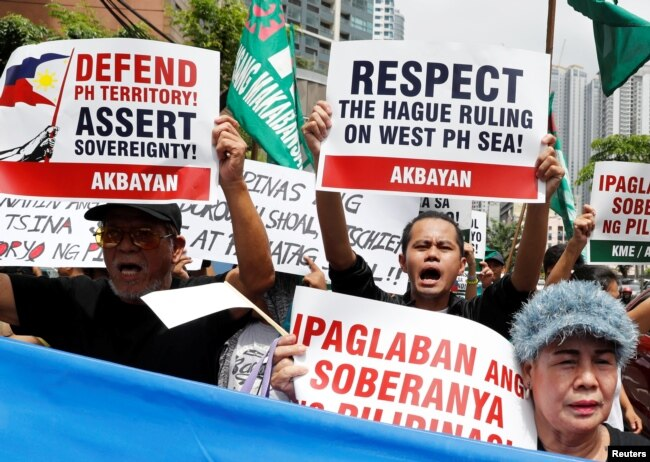 Members of the Akbayan activist group chant anti-China slogans as they march toward the Chinese consulate during a rally on the South China Sea dispute, in Makati, Metro Manila, in Philippines, July 12, 2018. Two years ago China lost a World Court arbitration case.