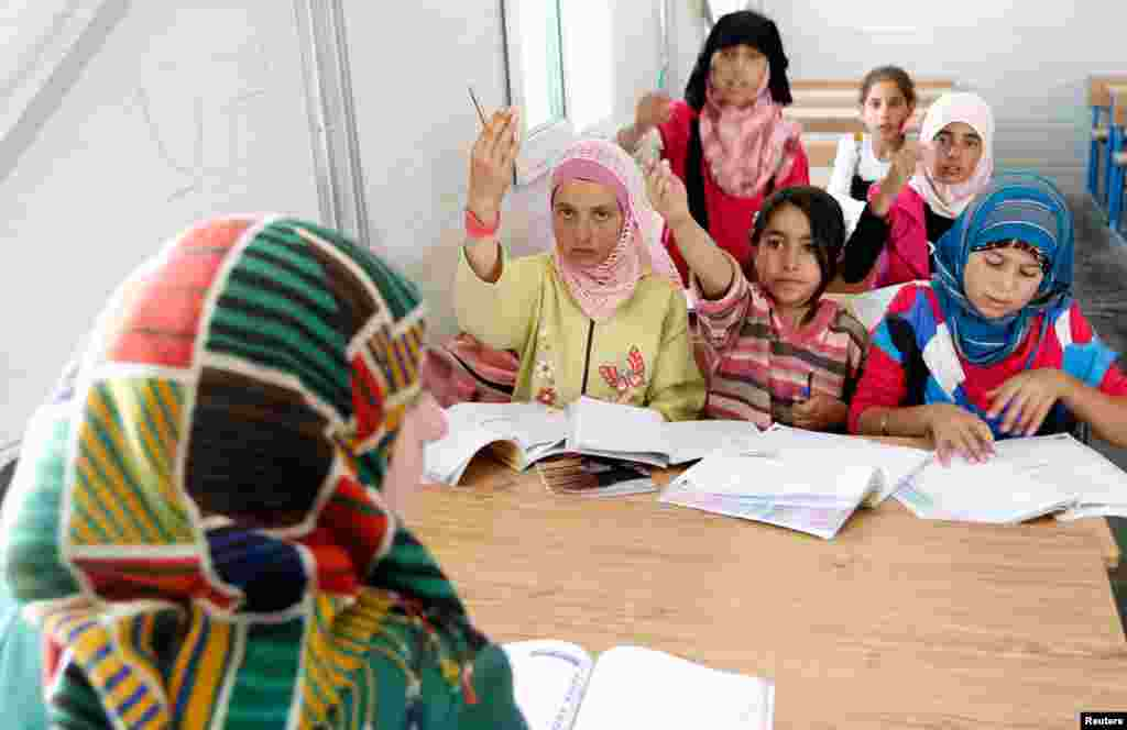 Syrian refugee children attend class at a new school at the Al Zaatri refugee camp in Mafraq, Jordan, near the border with Syria, June 4, 2013.