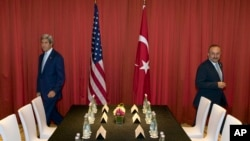FILE - U.S. Secretary of State John Kerry, left, and Turkish Foreign Minister Mevlut Cavusoglu prepare to take part in a meeting ahead of the G20 summit in Hangzhou in eastern China's Zhejiang province, Sept. 3, 2016.