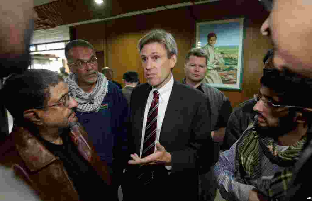 Then-U.S. envoy Christopher Stevens speaks to local media before attending meetings at the Tibesty Hotel where an African Union delegation was meeting with opposition leaders in Benghazi, Libya. (April 2011 file photo)