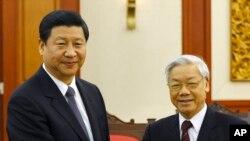 Ông Tập Cận Bình và Tổng Bí Thư Đảng Cộng Sản Việt Nam Nguyễn Phú Trọng tại Hà Nội (Ảnh tư liệu của AP năm 2011).