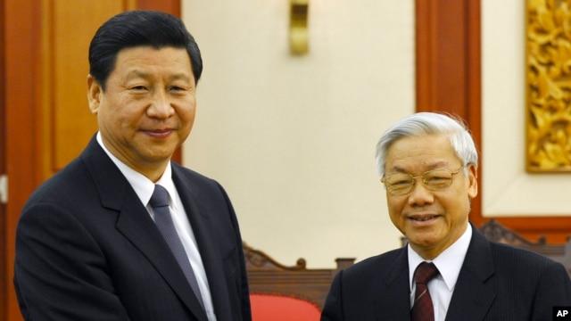 Tổng Bí thư Nguyễn Phú Trọng và Chủ tịch Trung Quốc Tập Cận Bình trong chuyến thăm Việt Nam hồi tháng 12, 2011. (Ảnh tư liệu).