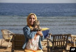 In this photo provided by el-Taweel family, Aug. 7, 2015, jailed Egyptian photographer Esraa el-Taweel poses for a photo in Egypt's Dahab beach in 2015.
