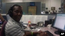 John Tanza busy at work at the VOA headquarters in Washington DC