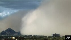 A massive dust storm moves into the metro area Saturday, July 21, 2012, in Phoenix.(AP Photo/Ross D. Franklin)