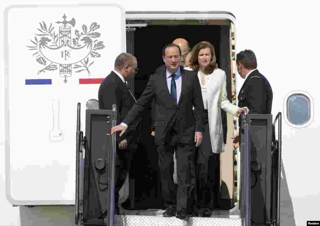 French President Francois Hollande and his companion Valerie Trierweiler arrive for the G8 Summit at Dulles International Airport in Virginia May 18, 2012.