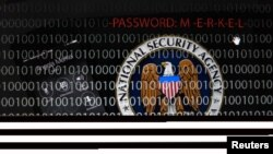 FILE - A mobile phone simulating a call ; a tablet computer showing the logo of the United Staes' National Security Agency (NSA) is seen in this multiple exposure picture.
