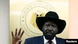 South Sudan's President Salva Kiir gestures during a news conference in Juba, Dec. 18, 2013.