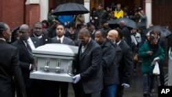 FILE - Pallbearers carry the casket of Akai Gurley during his funeral in Brooklyn, N.Y., in December; New York City Police Officer Peter Liang reportedly has been indicted in the fatal shooting of Gurley.