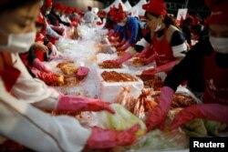 People take part in the Seoul Kimchi Festival in central Seoul, South Korea, Nov. 3, 2017.