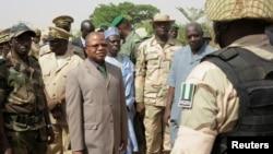Mali's Prime Minister Diango Cissoko (3rd L) reviews Nigerian soldiers at their base in the town of Banamba,150km (93 miles) from Bamako, April 9, 2013.