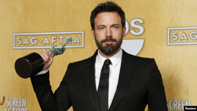 "Director and actor Ben Affleck holds the award for outstanding performance by a cast in a motion picture for ""Argo"" at the 19th annual Screen Actors Guild Awards in Los Angeles, California January 27, 2013."