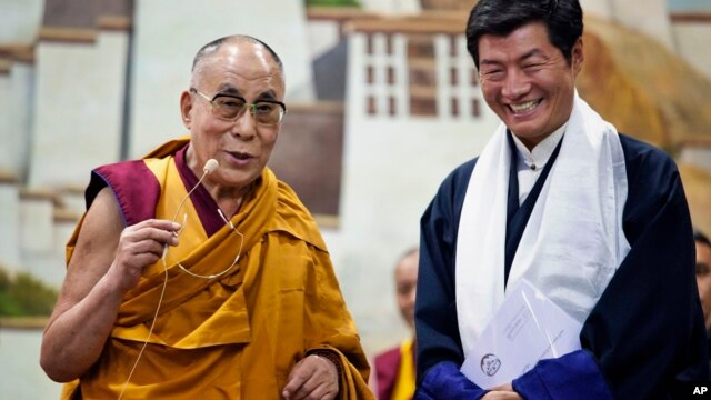 Lobsang Sangay, prime minister of the Tibetan government-in-exile, right, and the Dalai Lama visit the Tibetan Children's Village School in Dharmsala, India, on June 5, 2014.