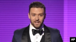 FILE - Justin Timberlake accepts the award for favorite male artist - pop/rock at the American Music Awards at the Nokia Theater L.A. Live on Nov. 24, 2013, in Los Angeles.