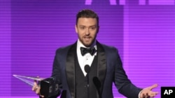 Justin Timberlake accepts the award for favorite male artist - pop/rock at the American Music Awards at the Nokia Theatre L.A. Live on Nov. 24, 2013, in Los Angeles.