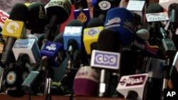 FILE - Vice president of Freedom Justice Party, the political branch of the Muslim Brotherhood, speaks at a press conference in Cairo, Egypt, May 25, 2012. Egyptian prosecutors ordered Hossam Bahgat be detained for four days in connection with charges of spreading false information that harms the country's national security.