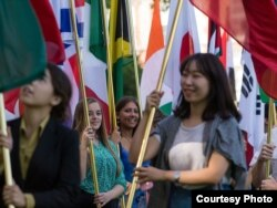 International students carry their national flags at the University of Missouri in Columbia, Missouri.
