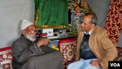 Muhammad Shaban Butt (left) speaks with VOA reporter Yusuf Jameel.