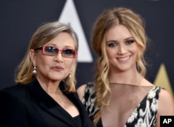 FILE - Carrie Fisher and her daughter, Billie Catherine Lourd, arrive for an awards ceremony at the Dolby Ballroom in Los Angeles, Nov. 14, 2015.