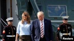 Prezidan Donald Trump ak Premyè dam nan Melania Trump.