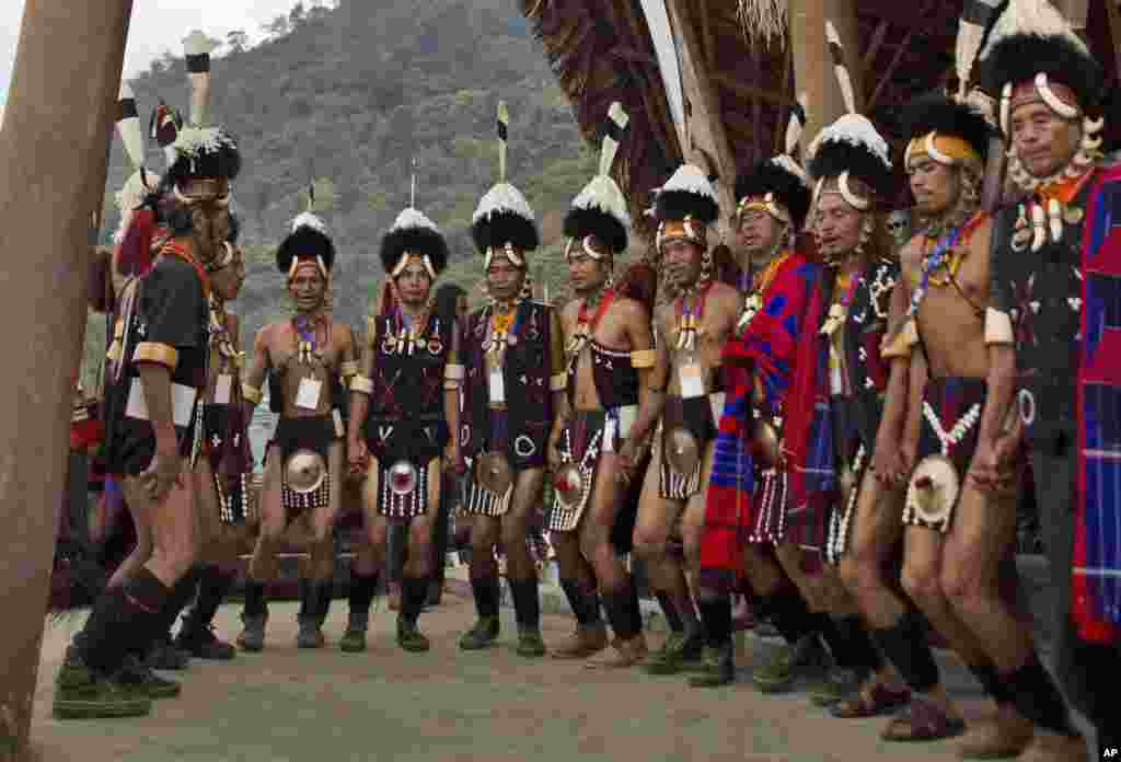 Naga tribal men perform a traditional dance during the Hornbill festival at the Kisama village in Nagaland, India. The 10-day long festival named after the Hornbill bird is one of the biggest festivals of India's northeast that showcases the rich tradition and cultural heritage of the indigenous Nagas.