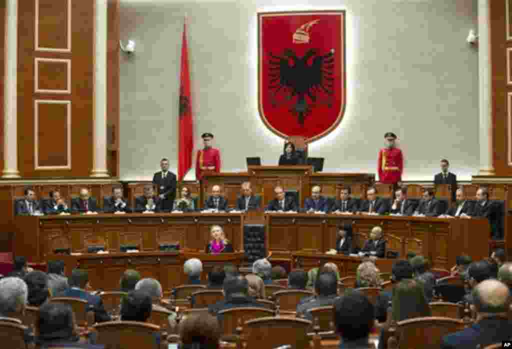 US Secretary of State Hillary Clinton, centre, speaks to the Albanian Parliament in Tirana, Albania, Thursday, Nov. 1, 2012. Hillary Clinton arrived in EU-hopeful Albania on the last leg of her Balkans tour where she is expected to urge opposing political